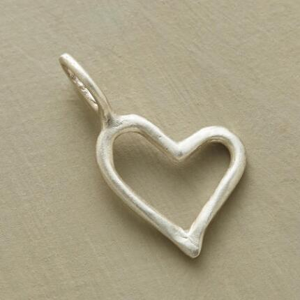 This sterling heart charm brings a shining sweetness to any bracelet or necklace.