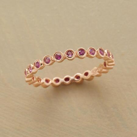 Dainty as can be, this particularly pink sapphire ring makes a sweetly elegant statement.