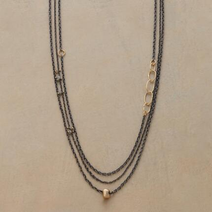 A chic three-chain raw diamond necklace that draws the eye with its thoughtfully plotted asymmetry.