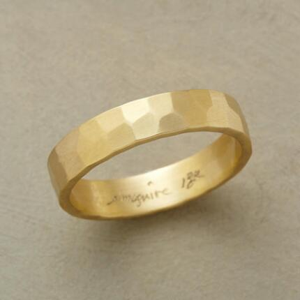 An 18kt matte gold band that stuns with its textured yet simple design.