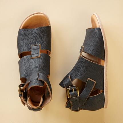 Comfortable and chic, these leather sandals with brass buckles are an everyday essential.