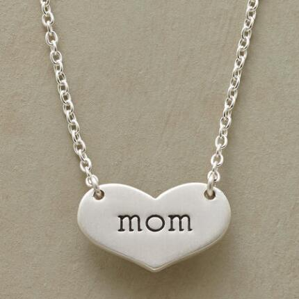 Simply sweet, this engraved heart pendant necklace will become a precious keepsake.