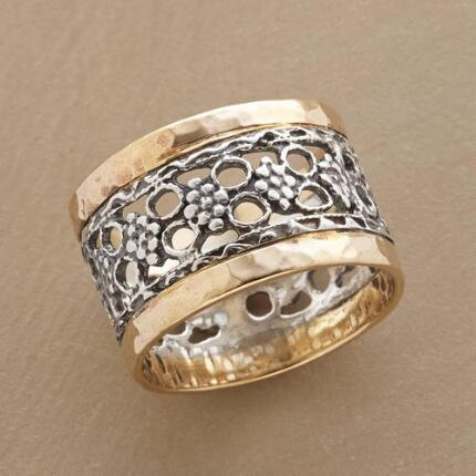 With delicate details and a bold design, this garden gate floral ring is simply stunning.