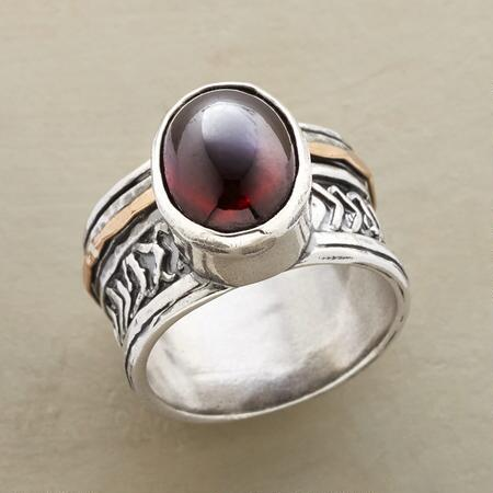This sumptuous red garnet cabochon bezel ring has an inescapable allure.
