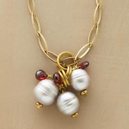 With a glow like moonlight, this long pearl and garnet necklace is utterly classic.