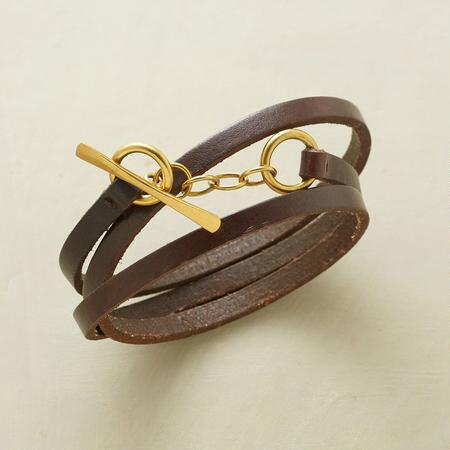 Rustically becoming, this leather embrace wrap bracelet makes a distinctive addition to any ensemble.