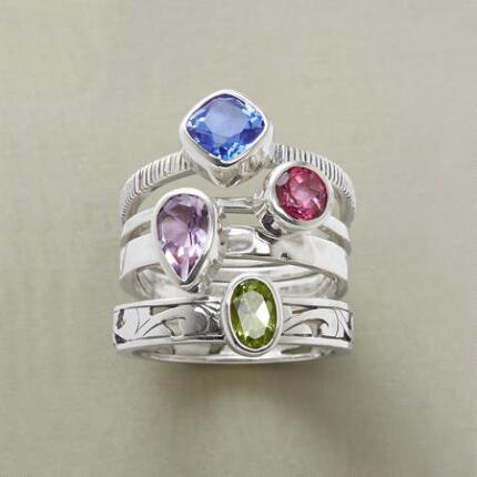The four bands of this unique gemstone ring set can stand alone or play together perfectly.