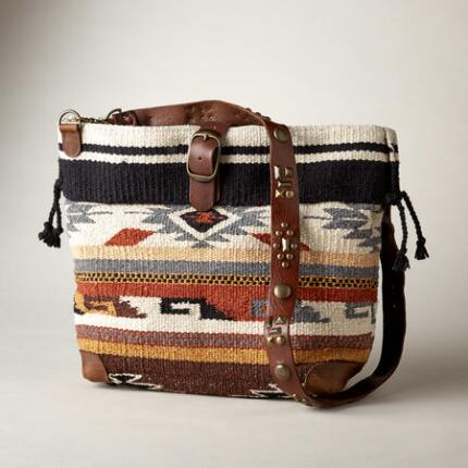 This crossbody wool blanket bag makes a distinctive addition to any look.