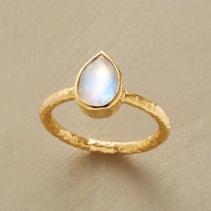 You'll be dazzled by this handcrafted moonstone drop ring's captivating radiance.