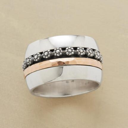 This wildflower channel ring complements a bold band with dainty details.