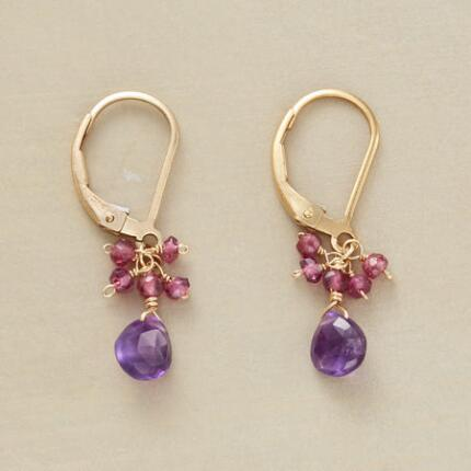 A pair of gemstone dangle earrings that entrances with its sweet sparkle.