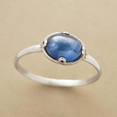 A heavenly oval sapphire ring, with a jewel that could make the sky itself envious.