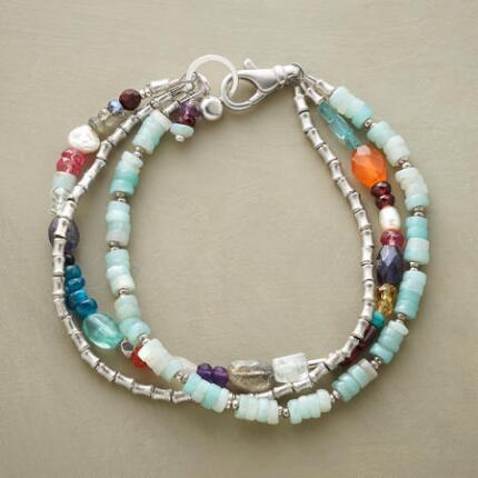 Mixing serene and vibrant hues, this colorful gemstone and sterling bracelet will enliven any look.