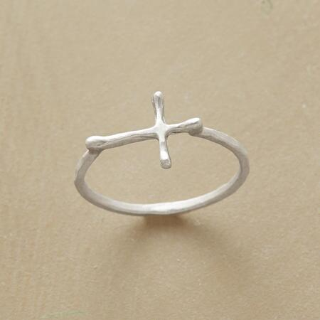 A handcrafted sterling cross ring with a design that delights the eye and the spirit.