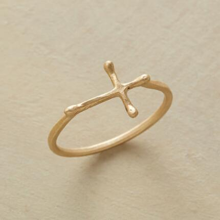 A 10kt gold cross ring with a unique design that will draw your eye and raise your spirit.