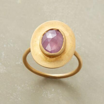 A handmade pink sapphire ring that sets delicate color in a bold design.