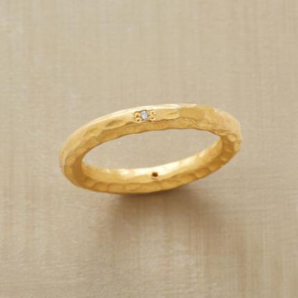 With its classic design and lovely texture, this diamond compass band ring is eminently wearable.