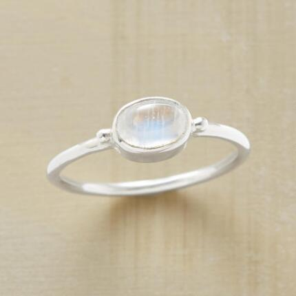 Our handmade moonstone cabochon ring dazzles with its nacreous flashes of color.