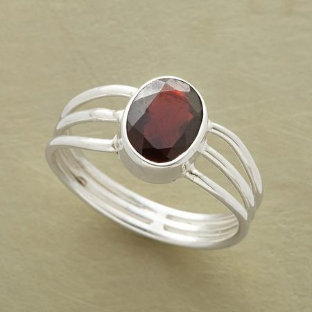 With a color so rich, the red garnet Angelica ring needs three bands to hold it.