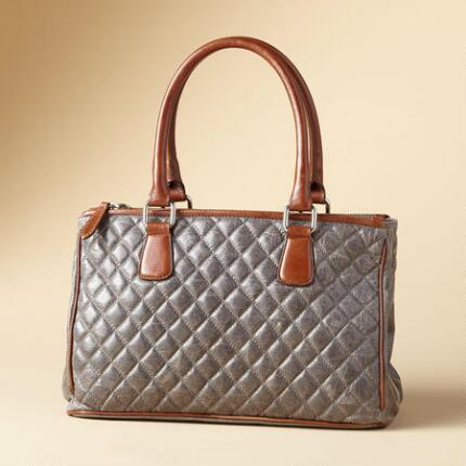 Enjoy versatile yet distinctive style with this quilted leather bag.