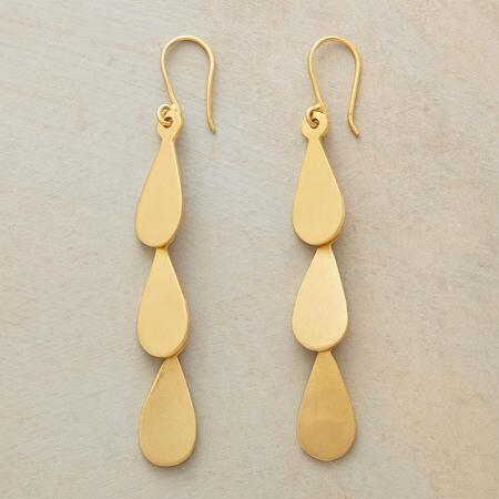 These Jane Diaz golden teardrop earrings will rain bright light down on any look.