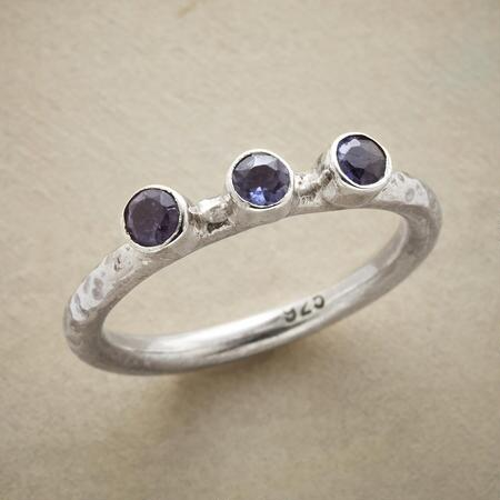 This three gemstone iolite ring will charm you with its sweet simplicity.