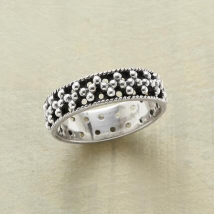 In this silver spheres ring, volume and void call to each other and answer.