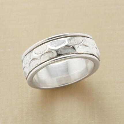 The textured design of this sterling silver band ring makes the simple piece unique.