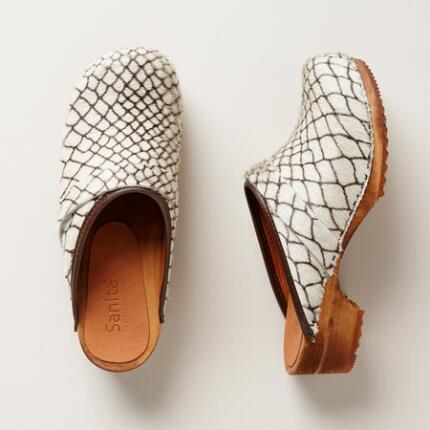 These Sanita® haircalf and wood clog shoes update a timeless design with a touch of modern attitude.