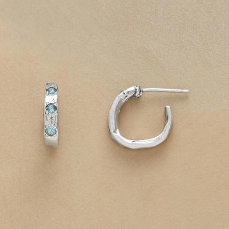 These sparkling little topaz hoop earrings pack brilliant star power.