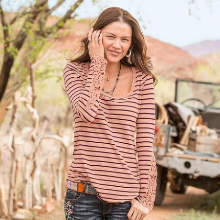 A scoop neck striped tee shirt design that accents an easy-going style with feminine detailing.