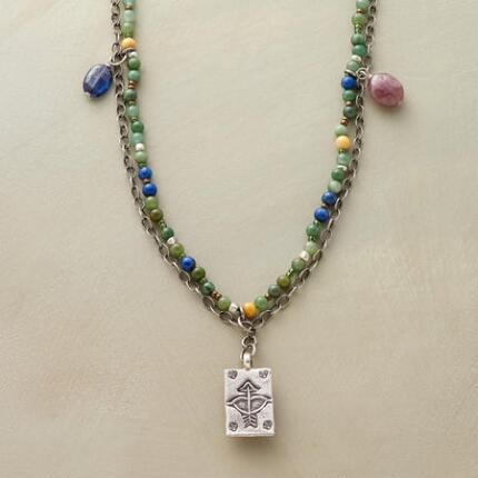 With its gracefully subdued hues, this long gemstone and pendant necklace makes a subtly colorful touch.
