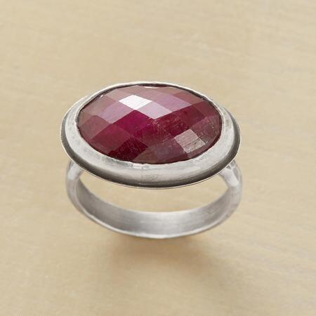 This sterling bezel set ruby ring will stun you with its rich tones and classic design.