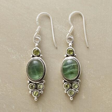 Our exclusive peridot and apatite earrings bring a touch of refined verdancy to any ensemble.
