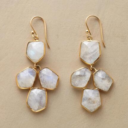 Our exclusive moonstone chandelier earrings radiate an ethereal grace.