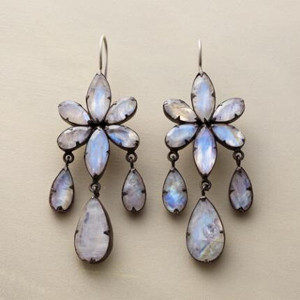 A pair of Jane Diaz moonstone chandelier earrings that shines with otherworldly light.