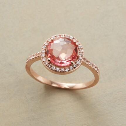 Add a delicate sense of romance to your outfit with this rose-cut pink topaz ring.