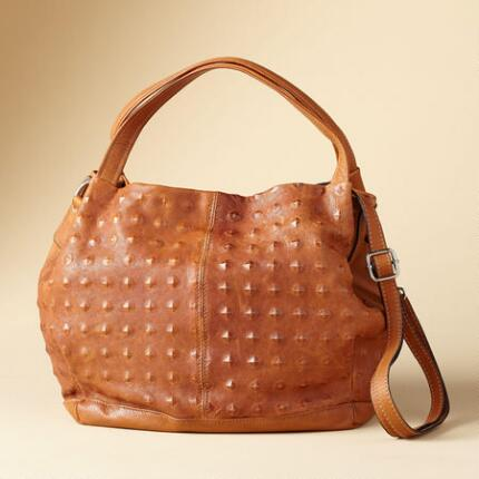 This Italian embossed leather bag makes a truly distinctive addition to any look.