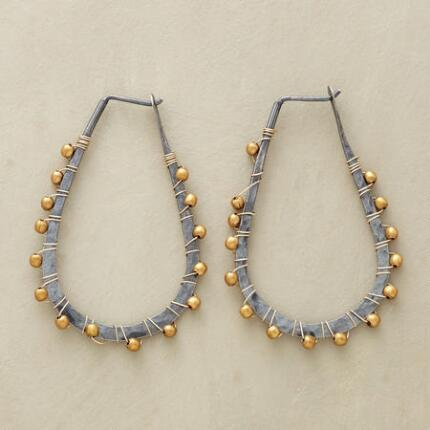 Lashed with bright accents, these brass wire and bead hoop earrings are utterly unique.