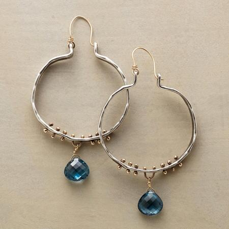 These first rain hoop earrings enhance the glamour of this classic design by adding a solitary dangling jewel.