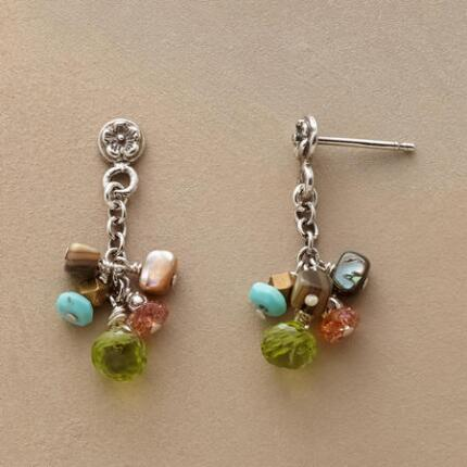 These exclusive floral gemstone earrings bring together a lively grouping of precious materials.
