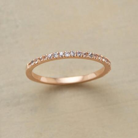 This delicate white sapphires stardust band will twinkle its way into your heart.