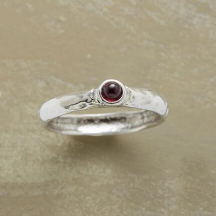 This red garnet hammered band ring adds just the right touch of rich color to your look.