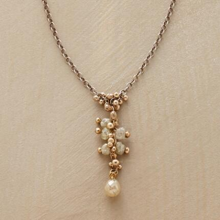 Delicate yet stunning, this dangling diamond necklace is a truly special piece.