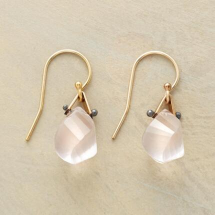Uniquely designed yet delicate, these spiral-cut rose quartz earrings draw the eye.