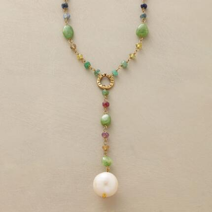 This dangling pearl and gemstone necklace has a lively elegance all its own.