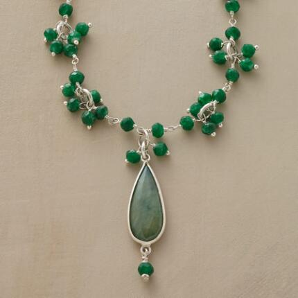 An emerald teardrop and cluster necklace replete with lovely, lush hues.
