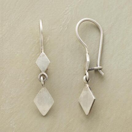 This pair of sterling diamond duo earrings has a refined design that will suit an ensemble.