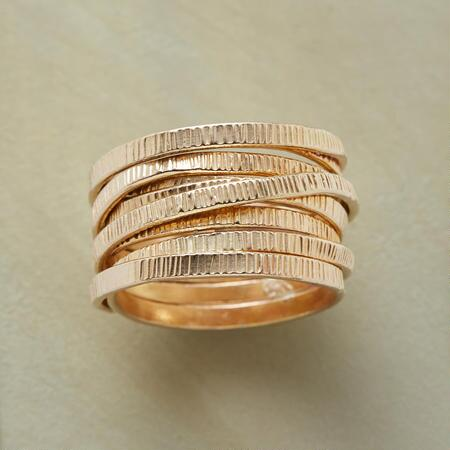 A gorgeous convolution of goldfill, this unique ribbon twist ring will be an instant favorite.