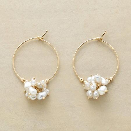 A luminous froth of pearls and gold beads spills from these Keshi pearl hoop earrings.